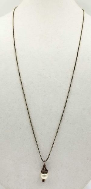 "Brass, copper, & pearl pendant necklace. 34"" Opera length."