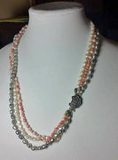 "3-strand necklace, pearl & coral, individually knotted with silk.  Vintage sterling clasp. 24"" Matinee length."