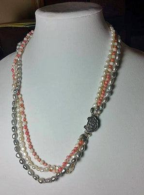 3-strand necklace, pearl & coral, individually knotted with silk.  Vintage sterling clasp.