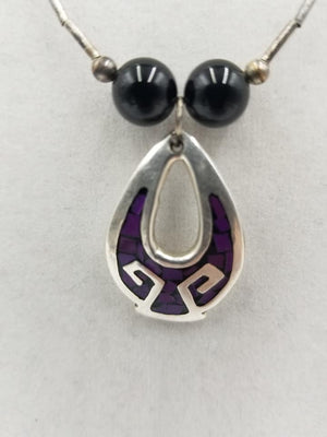 Liquid Sterling silver, onyx & enamel Thunderbird pendant necklace. Opera length, 28