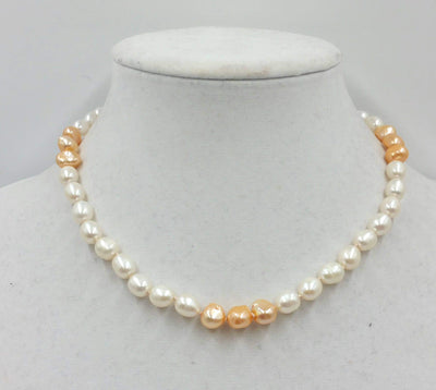 2-tone pearl choker with sterling silver clasp and accents on beige silk. 17in length.
