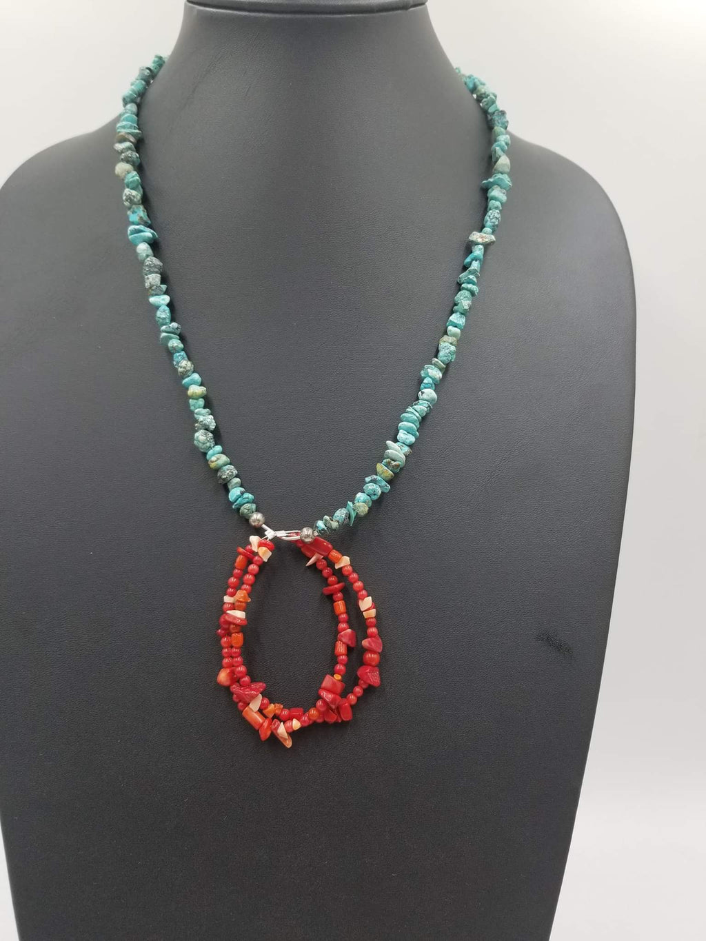 "Adjustable sterling, turquoise, howlite, Navajo style necklace, coral pendant. 23-26"" Matinee length."