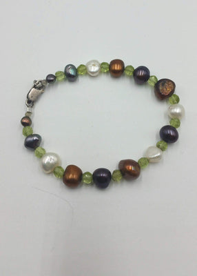 Sterling silver, peridot, multi-color freshwater pearls, moonstone accents bracelet.