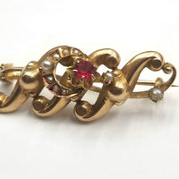 14KYG brooch with Pearl's and synthetic ruby.