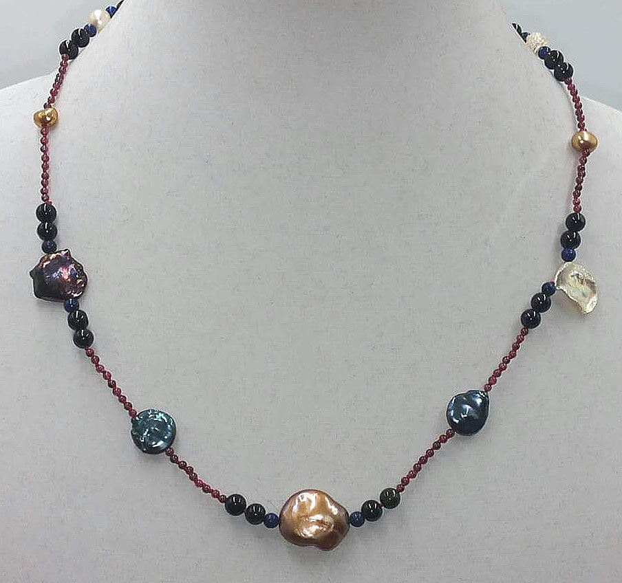 Garnet, tourmaline, lapis and multicolor pearl necklace with 14KYG clasp on scarlet silk.