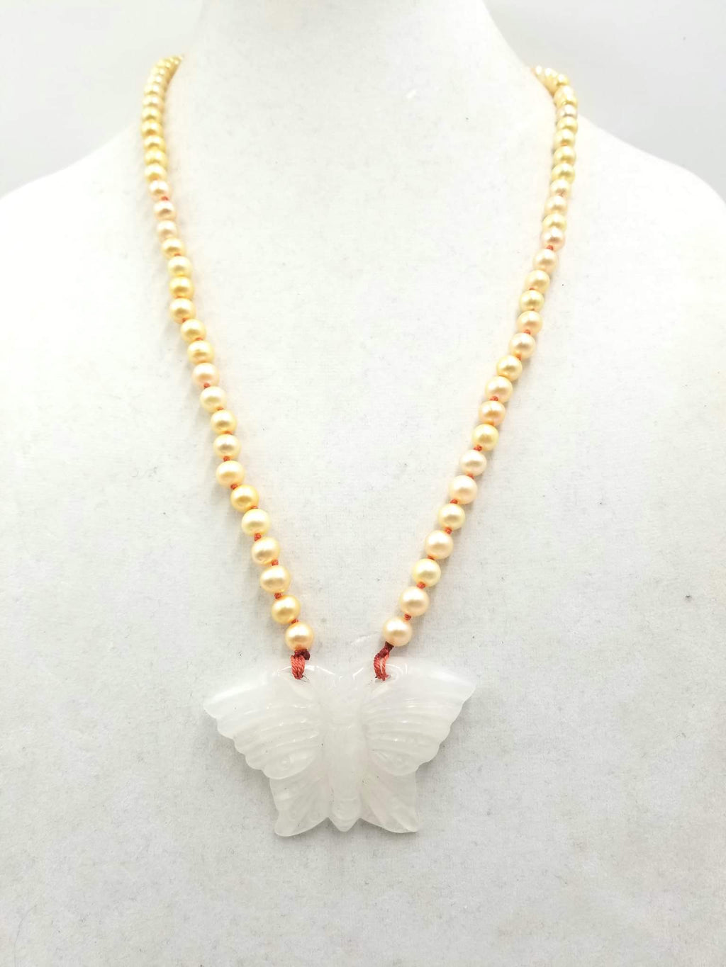 "Icy white jadeite butterfly & golden pearl necklace with hand-knotted crimson silk. 25"" length."