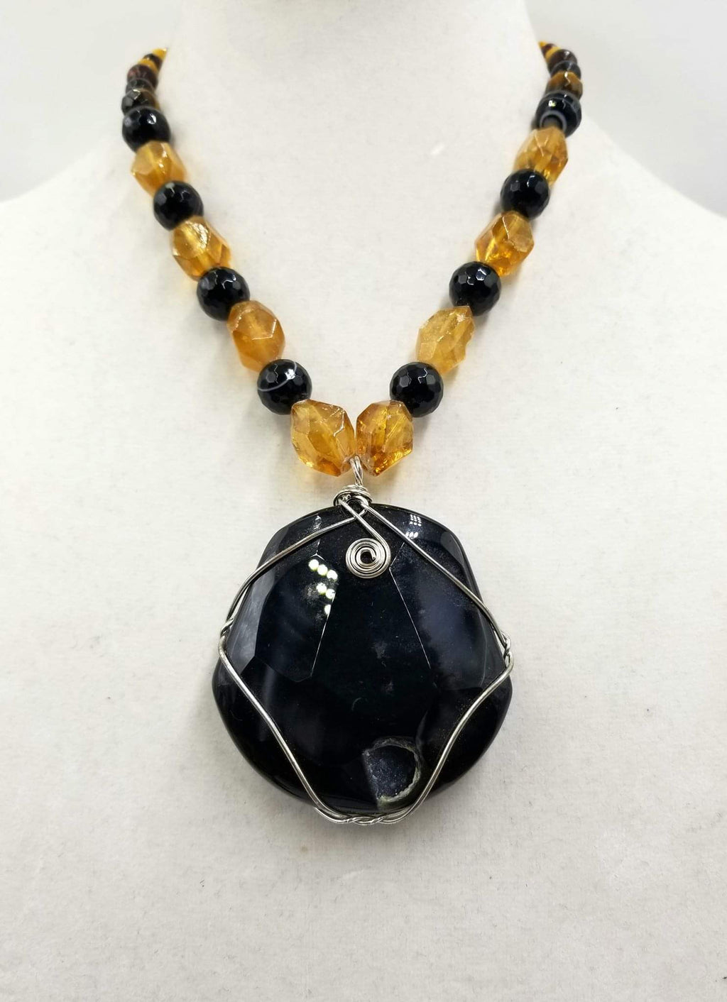 Bold calcite, onyx, & tiger's eye pendant on sterling silver necklace.
