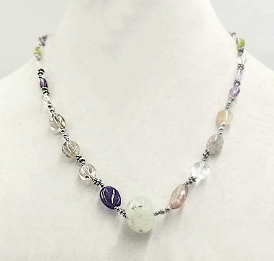 So pretty! Amethyst, citrine, clear quartz, & peridot necklace, with prehnite focal. Hand-knotted with blue silk.