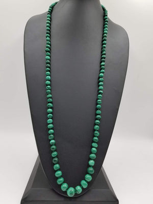 "Graduated rope of vintage malachite, on hand-knotted silk necklace. 39"" Length."
