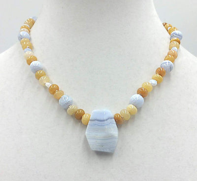 Precious yellow jadeite, & blue lace agate on pale pink silk with vintage sterling silver clasp. 18