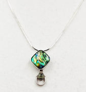 Sterling silver, abalone, and peridot pendant necklace.