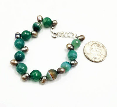 Adjustable sterling silver green banded agate and grey pearl bracelet.