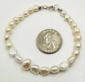 Plus size sterling silver, graduated white pearl bracelet. Classic!