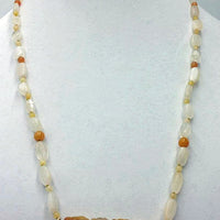 Precious yellow & orange jadeite, moonstone, & 14KYG necklace on bright yellow silk.