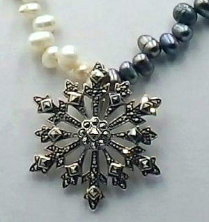 Marcasite pendant with bi-tone pearl necklace and sterling silver clasp.