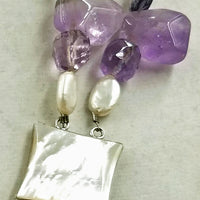 Wild, bold, gorgeous, two-strand amethyst, pearl, shell, & sterling silver necklace. If interested, please contact us.