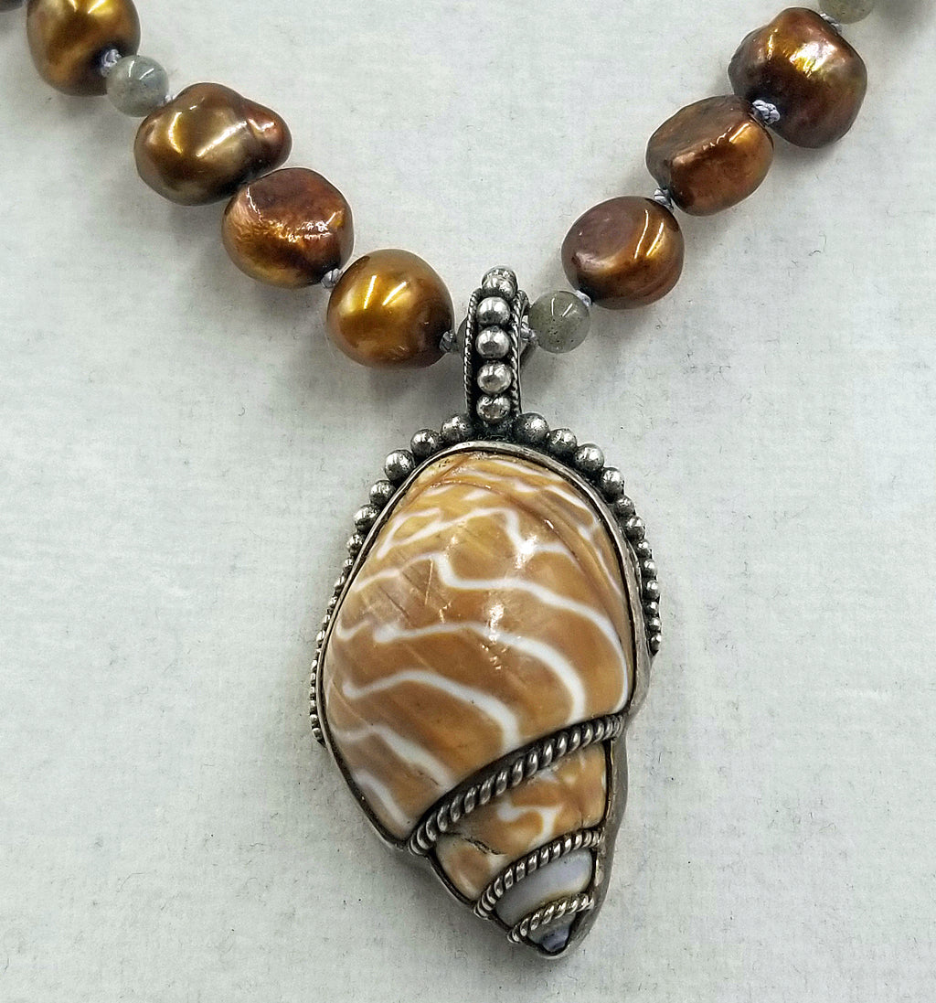 Bronze pearl shell pendant, labradorite, & sterling silver necklace on dove grey silk.