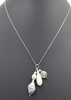 Pearls, jadeite sterling silver triple charms necklace.