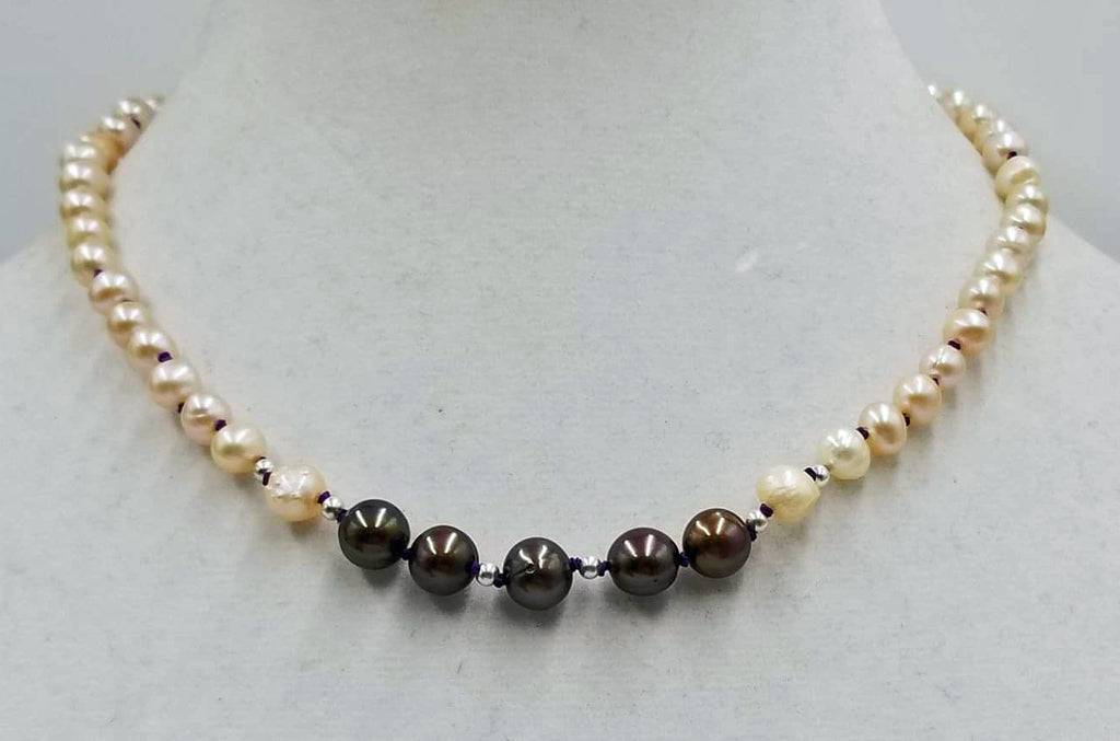 "Adjustable choker made of cultured pearls. Sterling Silver clasp. 13.5 - 17.25"" length."