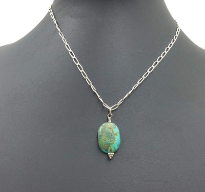 Turquoise-dyed howlite pendant on a sterling silver chain.