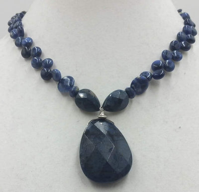 Sodalite and sterling silver pendant necklace.