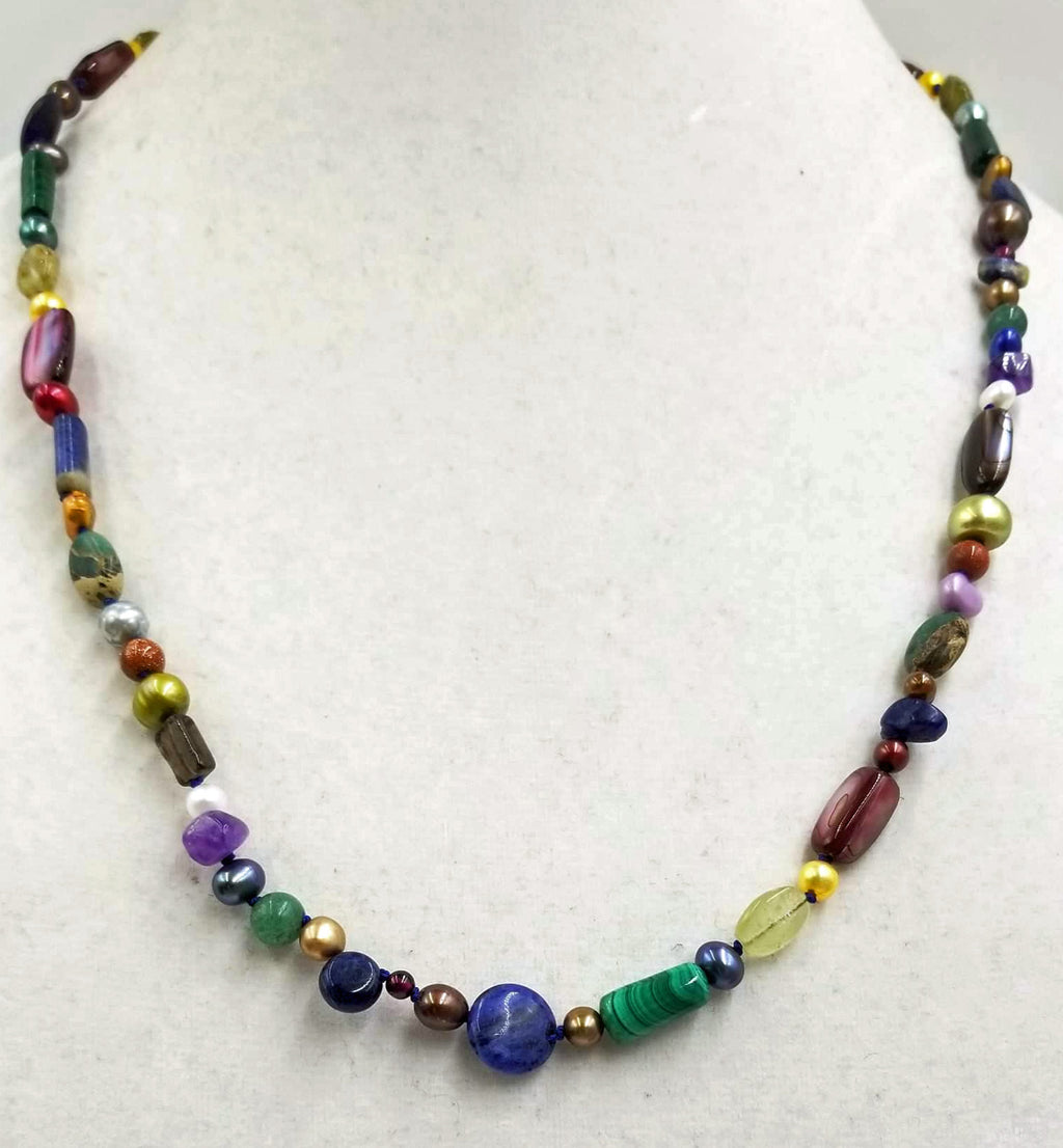 "Cosmic necklace, hand-knotted. With pearls, garnets, jasper, etc. 25"" Matinee length."