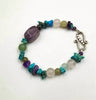 Amethyst, jadeite, dyed howlite, and rose quartz sterling silver bracelet.  6.75""