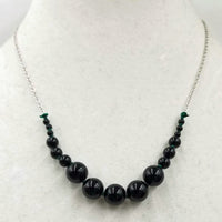 Graduated Black onyx & sterling silver necklace on verde silk.