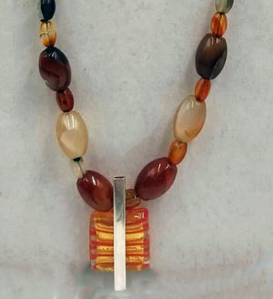 Sterling silver, carnelian, & flame agate necklace with Murano glass pendant on verde silk.