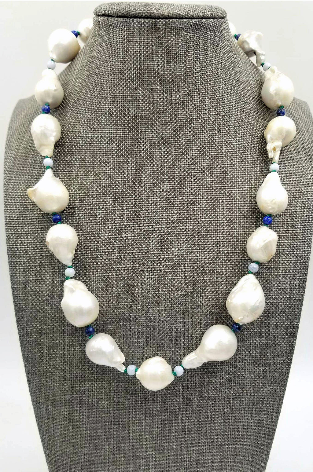 "Unique, Baroque pearls, lace agates, and lapis lazuli, sterling silver necklace on verde silk. 19"" Princess length."