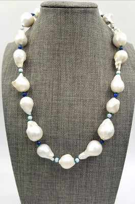 Looking for a statement piece that is Bold, Wild, & Elegant? Large Baroque pearls are for you.