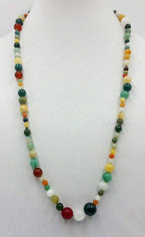Jadeite jade, light green silk, asymmetrical necklace.