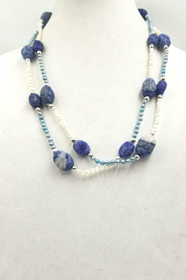 Ultra long art deco inspired freshwater cultured pearls, lapis lazuli, and sterling silver necklace.