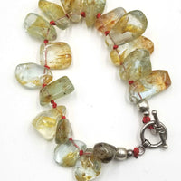 Rutilated Quartz, sterling silver toggle bracelet on scarlet silk.