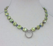 Sterling silver, green pearl, art glass, and CZ pendant necklace on pale silk.