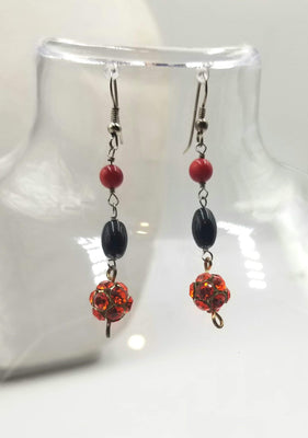 Sterling silver, onyx, coral, and red rhinestones earrings.