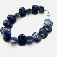 "If you love blue this is for you! Sodalite bracelet, with sterling silver clasp. 6 7/8"" length."