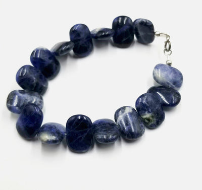 If you love blue this is for you! Sodalite bracelet, with sterling silver clasp.