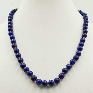 Vintage lapis hand knotted on coral silk necklace with Chinese silver clasp.The dark blue & crimson red make an impressive statement.