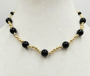 Simply Elegant. Vintage, 14K gold, black onyx necklace on white silk.