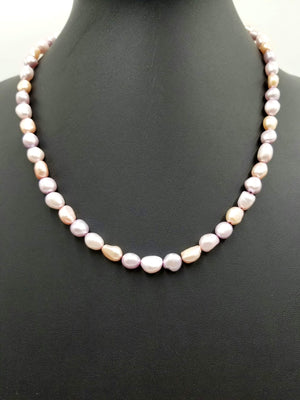 "Variegated pink Pearls, hand-knotted on silk with 14Kyellow gold clasp and accents.  Necklace. 20.5"" Length."