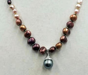 "Gorgeous, coppery pearls! Ombre multi-colored fresh-water cultured pearls & sterling silver pendant. 22"" length."