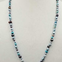 "Beautiful multi-color fresh-water cultured pearls on hand-knotted crimson silk. 28"" length."
