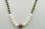 "Gorgeous. Fresh-water, cultured pearls, sterling silver necklace, hand-knotted with lavender silk. 26"" length."