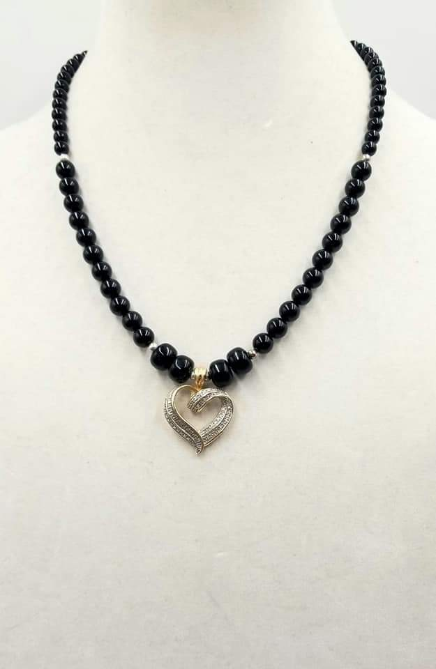 "Thinking of Valentines? This elegant sterling Silver, onyx, heart pendant necklace. 21.25"" could be the perfect gift. Length."