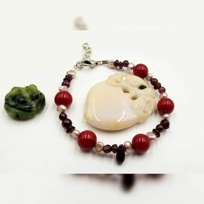 Past Work. Adjustable, sterling silver, pearl,coral,  & garnet bracelet.6.5-7.5
