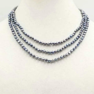 Be classy! Three-strand black pearl necklace with 14KYG bookclasp on twilight shades of silk.