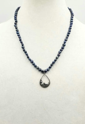 Classic. Vividly dyed black pearl necklace on black silk with sterling marcasite pendant.