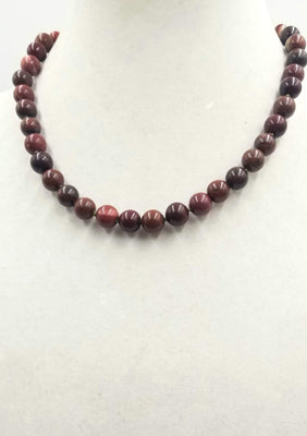 Sterling red jasper & iron tiger's eye necklace on moss green silk.