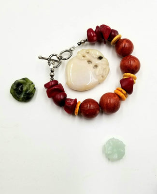 Sterling silver, sponge & red coral bracelet with yellow howlite. 6.25
